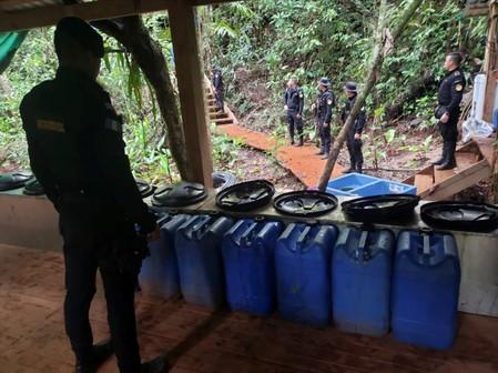 Agents of the Guatemalan National Civil Police (PNC) are seen during an operation to dismantle a coca processing lab in Izabal