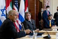 Israeli Foreign Minister Yair Lapid (L), US Secretary of State Antony Blinken (C) and United Arab Emirates Foreign Minister Sheikh Abdullah bin Zayed al-Nahyan take part in a joint news conference at the State Department (AFP/Andrew Harnik)