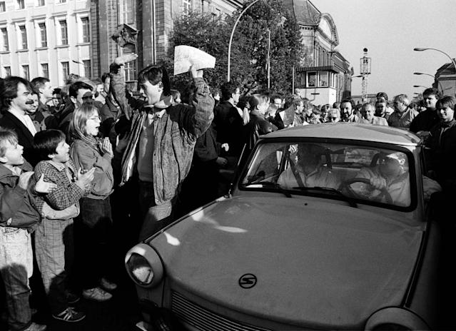 West Berlin citizens welcome East Germans who passed the Invalidenstrasse border checkpoint with an East German Trabant car after the opening of the border. (Photo: Fabrizio Bensch/Reuters)