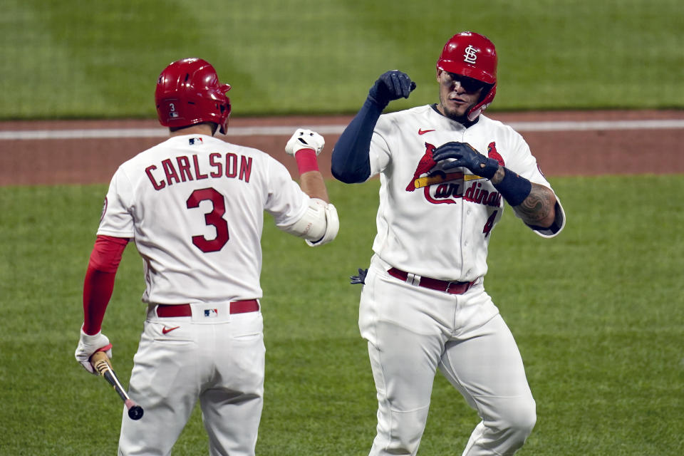 St. Louis Cardinals' Yadier Molina, right, is congratulated by teammate Dylan Carlson (3) after hitting a solo home run during the sixth inning of a baseball game against the Washington Nationals Monday, April 12, 2021, in St. Louis. (AP Photo/Jeff Roberson)