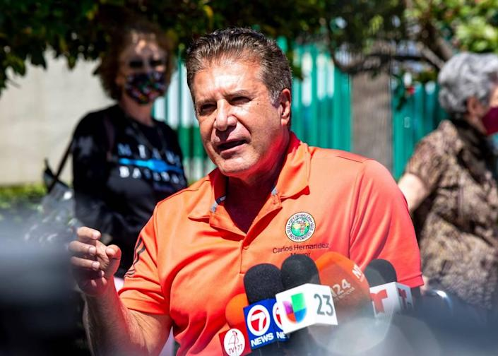 Mayor Carlos Hernandez speaks to the media as the city opens a new vaccination site at Bucky Dent Park in Hialeah, Florida, on Monday, March 15, 2021.