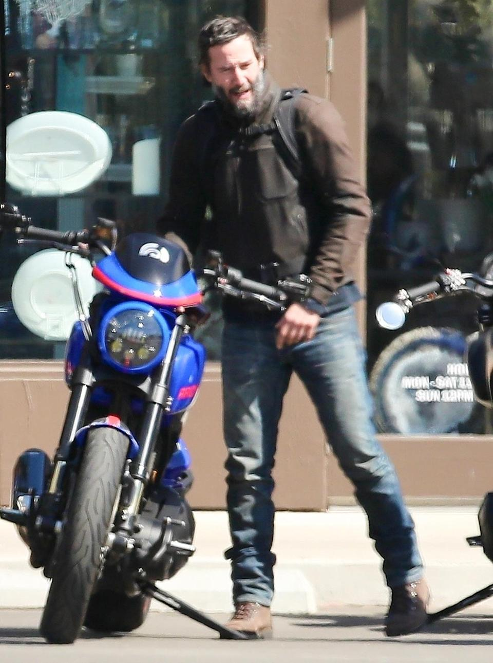 <p>Keanu Reeves chats with other bikers while out with his motorcycle in Malibu on Tuesday.</p>