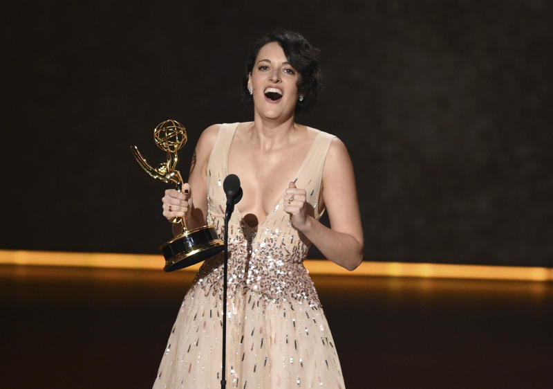"Phoebe Waller-Bridge accepts the award for outstanding writing for a comedy series for ""Fleabag"" at the 71st Primetime Emmy Awards on Sunday, Sept. 22, 2019, at the Microsoft Theater in Los Angeles. (Photo by Chris Pizzello/Invision/AP)"