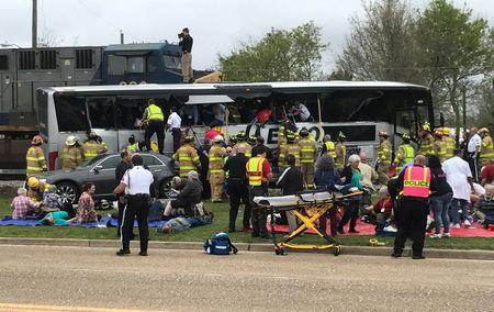 Biloxi firefighters tend to injured passengers escaping the wreckage after a train travelling from Austin, Texas, collided with a charter bus in Biloxi