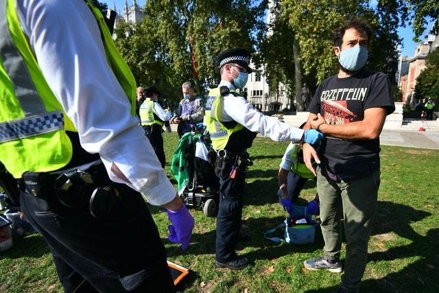 Police detain two Extinction Rebellion protesters in Parliament Square