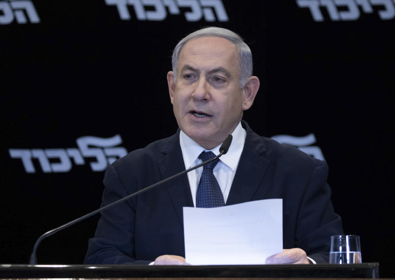 Israeli prime minister Benjamin Netanyahu reads a statement in Jerusalem, Wednesday, Jan. 1, 2020. Netanyahu said Monday that he would seek immunity from corruption charges, likely delaying any trial until after March elections, when he hopes to have a majority coalition that will shield him from prosecution. (AP Photo/Ohad Zwigenberg)