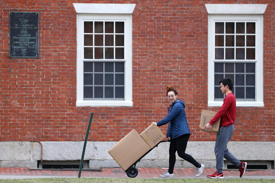CAMBRIDGE, MASSACHUSETTS - MARCH 12: Students move out of dorm rooms on Harvard Yard on the campus of Harvard University on March 12, 2020 in Cambridge, Massachusetts. Students have been asked to move out of their dorms by March 15 due to the Coronavirus (COVID-19) risk. All classes will be moved online for the rest of the spring semester.  (Photo by Maddie Meyer/Getty Images)