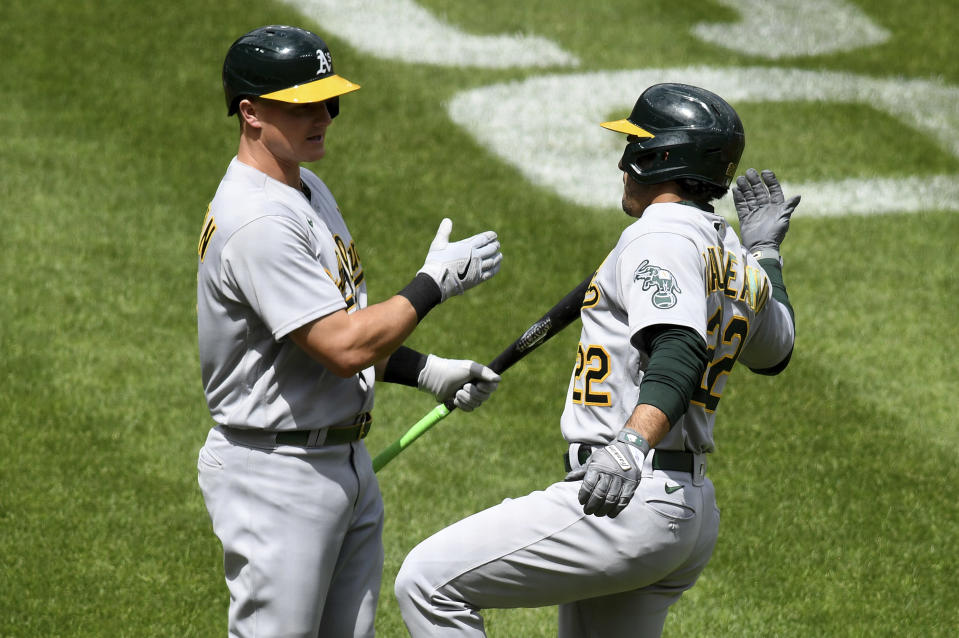 Oakland Athletics' Ramon Laureano (22) celebrates with teammate Matt Chapman (26) after hitting a solo home run against the Baltimore Orioles in the fourth inning of a baseball game, Sunday, April 25, 2021, in Baltimore. (AP Photo/Will Newton)