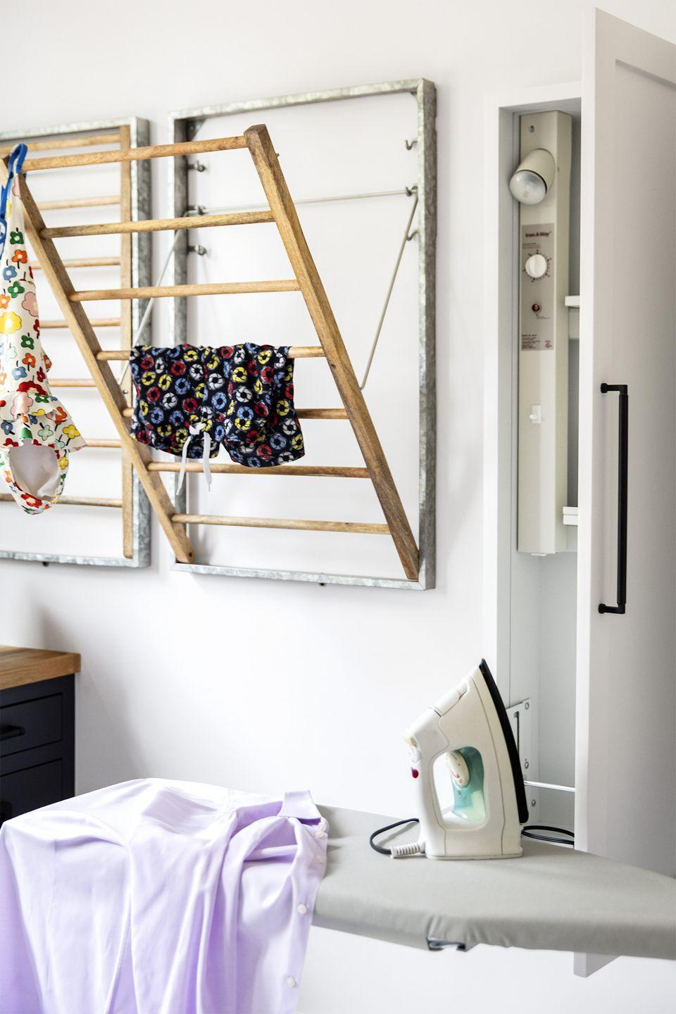 """<p>Boost your laundry room's functionality by mounting a few drying racks straight to the wall. When they're not in use, you can fold them up, so they don't get in the way of washing, drying and folding.</p><p><strong>RELATED: </strong><a href=""""https://www.goodhousekeeping.com/home/organizing/g25572553/laundry-room-ideas/"""" rel=""""nofollow noopener"""" target=""""_blank"""" data-ylk=""""slk:Clever Laundry Room Ideas"""" class=""""link rapid-noclick-resp"""">Clever Laundry Room Ideas </a></p>"""