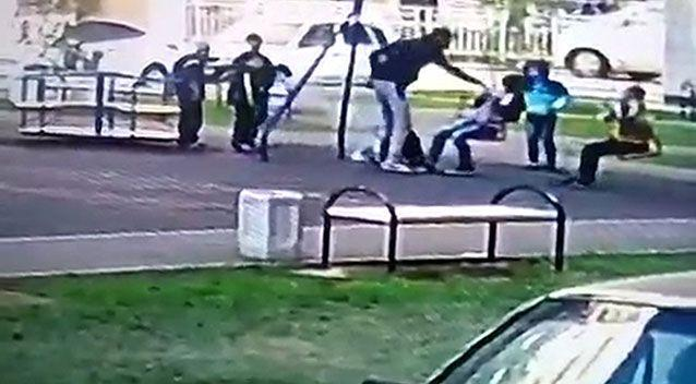 The dad in Russia can be seen approach the children and knocking one of them out in the footage. Photo: CEN