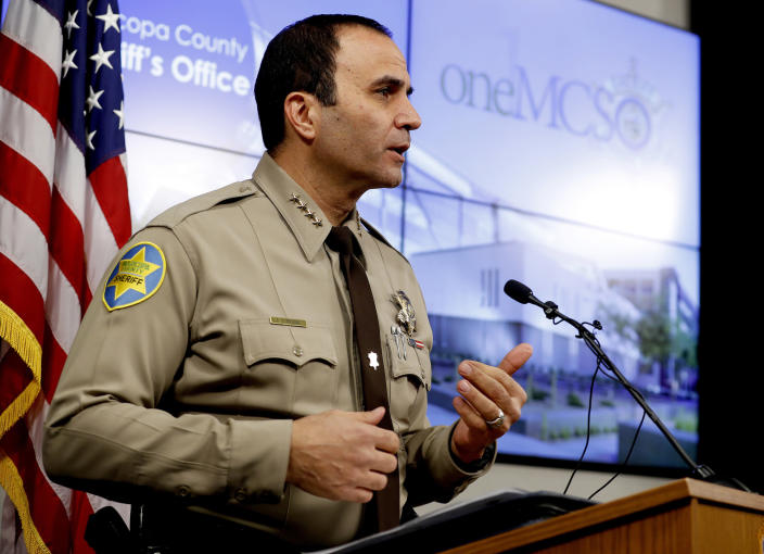 FILE - In this Feb. 14, 2019, file photo, is Maricopa County Sheriff Paul Penzone at a news conference in Phoenix. The taxpayer costs for the racial profiling lawsuit stemming from immigration patrols launched a decade ago by Penzone's predecessor, six-term Sheriff Joe Arpaio, are expected to reach $202 million by the summer of 2022. Officials approved a tentative county budget Monday, May 17, 2021, that provides $31 million for compliance costs in the fiscal year that begins on July 1. No one in county government can say exactly when those costs will start to decline or end. (AP Photo/Matt York, File)