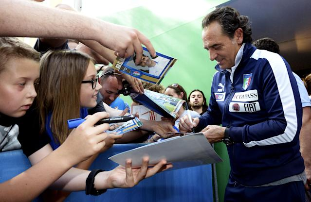 KRAKOW, POLAND - JUNE 29: Italy head coach Cesare Prandelli signs autographs for fans before a press conference ahead of the UEFA EURO 2012 Final against Spain at Casa Azzurri on June 29, 2012 in Krakow, Poland. (Photo by Claudio Villa/Getty Images)