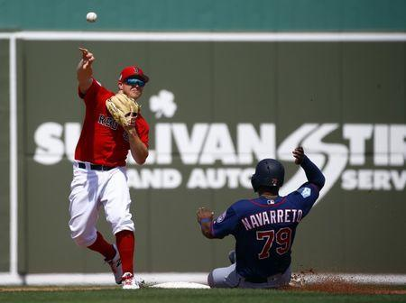 Mar 13, 2019; Fort Myers, FL, USA; Boston Red Sox second baseman Brock Holt (12) throws to first for a double play as Minnesota Twins catcher Brian Navarreto (79) slides into second base during the fourth inning of a game at JetBlue Park. Mandatory Credit: Butch Dill-USA TODAY Sports