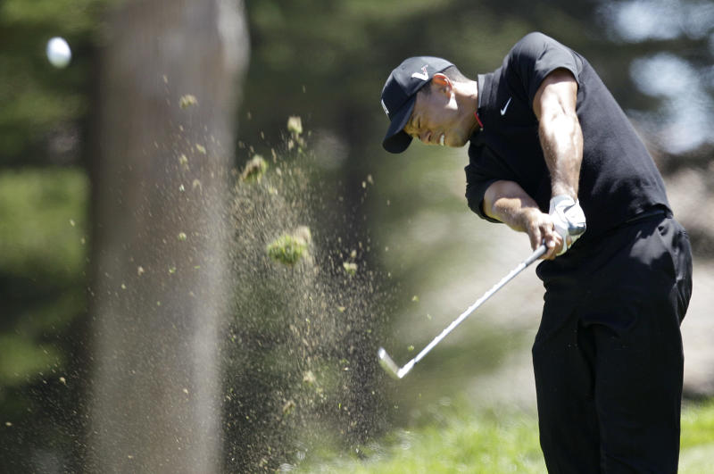 Tiger Woods hits a drive on the third hole during the second round of the U.S. Open Championship golf tournament Friday, June 15, 2012, at The Olympic Club in San Francisco. (AP Photo/Ben Margot)