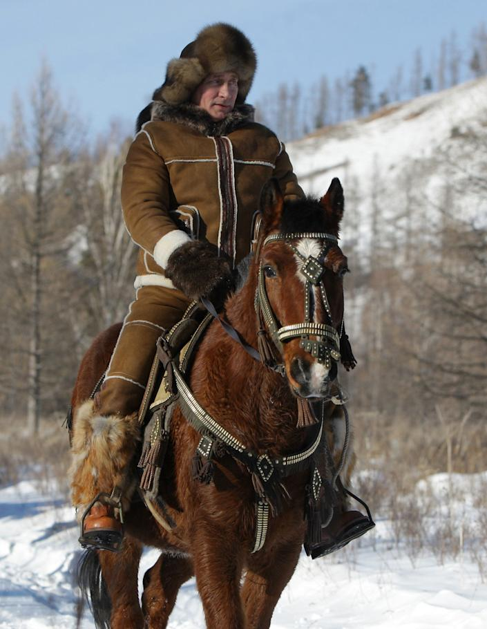 Putin rides a horse in the Karatash foothills in Siberia, Russia, on Feb. 25, 2010.