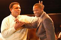 "<p>Muhammad Ali gestures behind Will Smith at the Miami Art Basel Taschen book premiere of Ali's new book, ""GOAT - Greatest Of All Time"" at the Miami Convention Center December 6, 2003 in Miami, Florida.</p>"