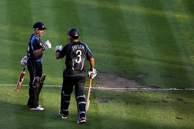 HAMILTON, NEW ZEALAND - FEBRUARY 12:  Brendon McCullum of New Zealand welcomes Ross Taylor to the crease during the international Twenty20 match between New Zealand and England at Seddon Park on February 12, 2013 in Hamilton, New Zealand.  (Photo by Hannah Johnston/Getty Images)