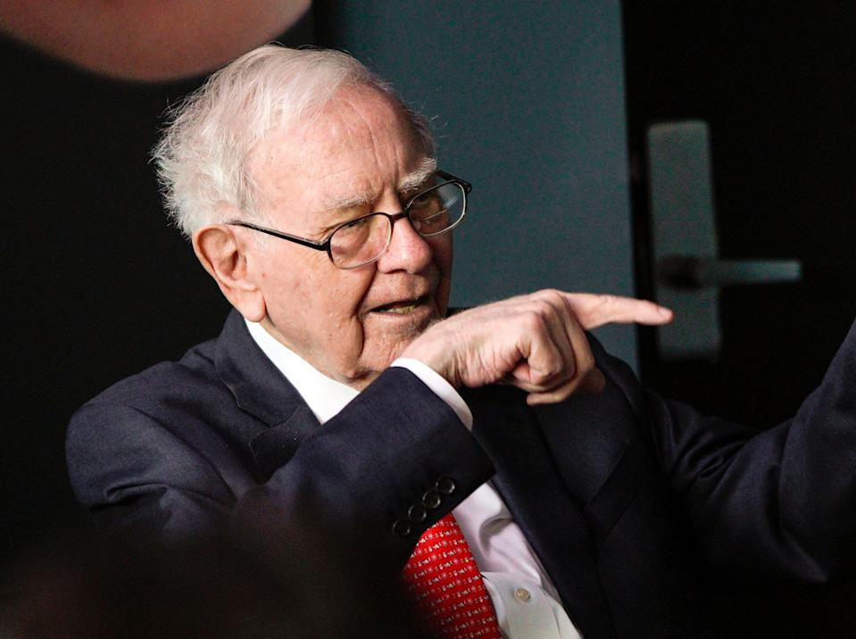 Warren Buffett, chairman and CEO of Berkshire Hathaway, gestures during a game of bridge outside Berkshire-owned Borsheims jewelry store in Omaha, Neb., Sunday, May 6, 2018. On Saturday, tens of thousands of Berkshire Hathaway shareholders attended the annual Berkshire Hathaway shareholders meeting. (AP Photo/Nati Harnik)
