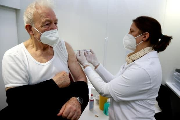 A man gets an injection of the AstraZeneca vaccine in Ebersberg near Munich on March 22.