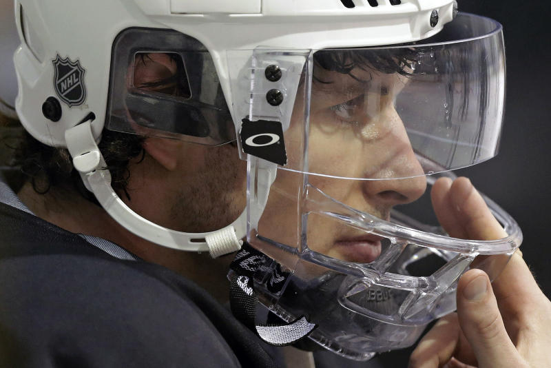 Pittsburgh Penguins' Sidney Crosby sits on the bench watching a power play drill during NHL hockey practice in Canonsburg, Pa., Tuesday, April 30, 2013. The Penguins take on the New York Islanders in the first round of the NHL hockey playoffs on Wednesday, May 1, in Pittsburgh. Crosby hasn't played since breaking his jaw a month ago. (AP Photo/Gene J. Puskar)