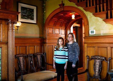Dr. Cindy Brownfield (L) and her 11-year-old daughter, Emma Brownfield, stand in their house, built in 1883, in the Museum Hill Historic District in St. Joseph, Missouri, U.S. November 15, 2016. REUTERS/Whitney Curtis
