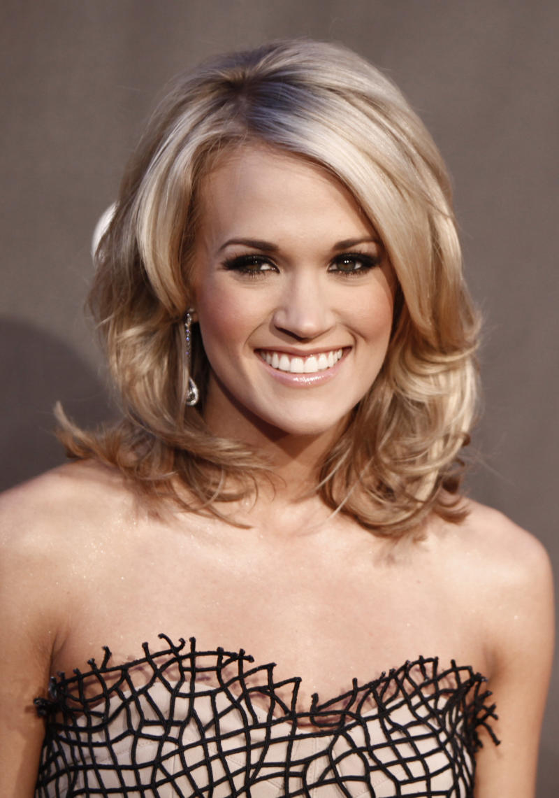 FILE - In this Jan. 6, 2010 file photo, Carrie Underwood arrives at the People's Choice Awards in Los Angeles. (AP Photo/Matt Sayles, File)