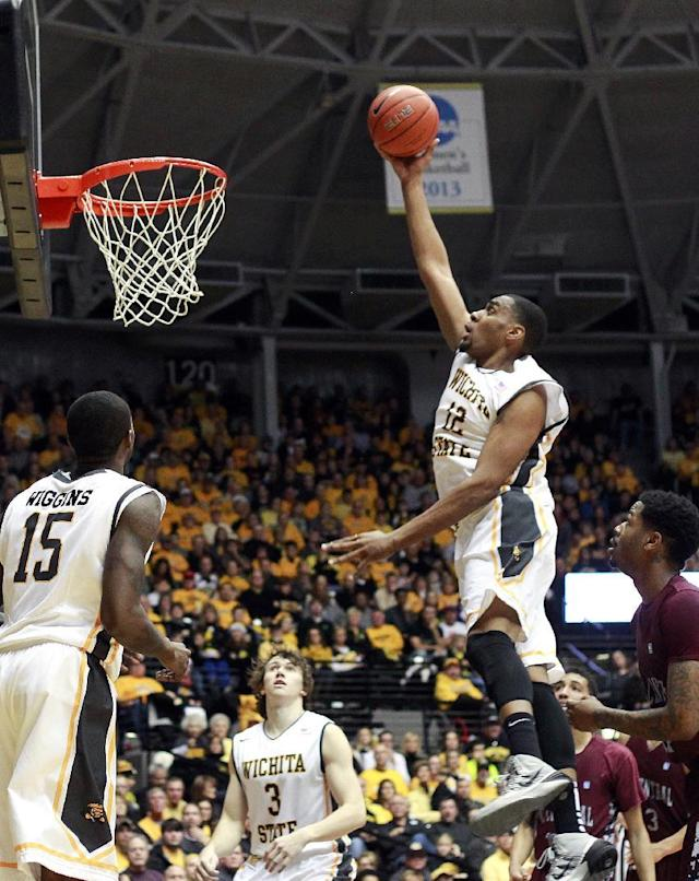 Wichita State's Darius Carter goes to the basket to dunk during the first half of an NCAA college basketball game against North Carolina Central at Koch Arena on Sunday, Dec. 22, 2013, in Wichita, Kan. (AP Photo/The Wichita Eagle, Jaime Green)