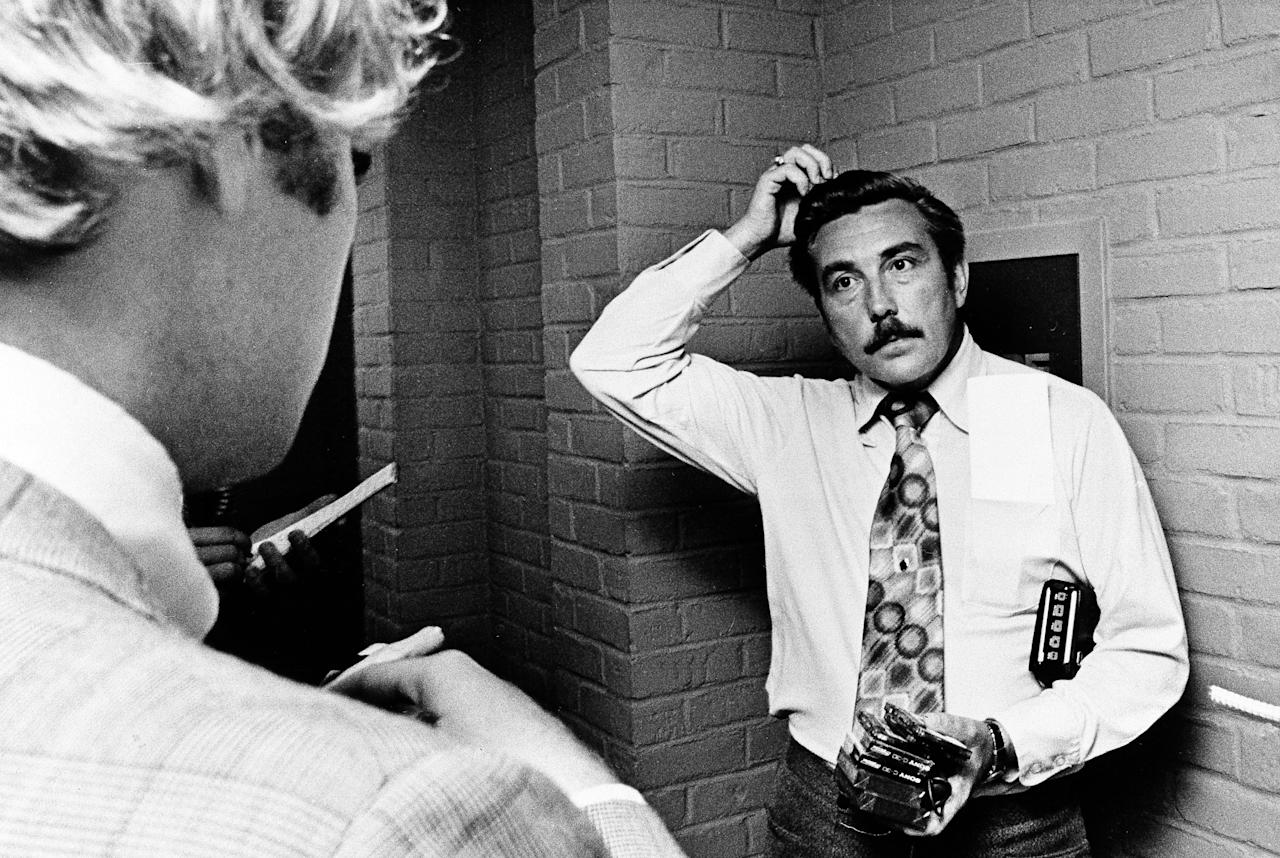 "FILE - In this Aug. 1, 1975 file photo Bloomfield Township Police Chief Robert Snell fields questions from reporters about the mysterious disappearance of former Teamster president Jimmy Hoffa. Hoffa was reported missing on July 31, 1975, after meeting with reputed Detroit mob enforcer Anthony ""Tony Jack"" Giacalone and alleged New Jersey mob figure Anthony ""Tony Pro"" Provenzano at a restaurant in Bloomfield Township, Mich. (AP File Photo)"