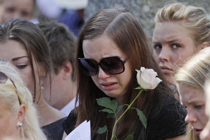 A mourner weeps during the funeral service for Bano Abobakar Rashid, 18, the first victim of the shooting rampage at Utoya to be buried, at a church in Nesodden, near Oslo, Norway, Friday July 29, 2011.  Rashid, whose family fled to Norway from Iran in 1996,  was one of the victims on Utoya island, where gunman Anders Behring Breivik killed at least 68 people, exactly one week ago. (AP Photo/Lefteris Pitarakis)