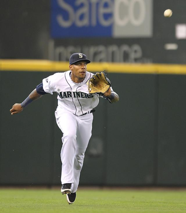 SEATTLE - JULY 17: Left fielder Greg Halman #56 of the Seattle Mariners makes a running catch of a fly ball off the bat of Mitch Moreland of the Texas Rangers in the seventh inning at Safeco Field on July 17, 2011 in Seattle, Washington. (Photo by Otto Greule Jr/Getty Images)