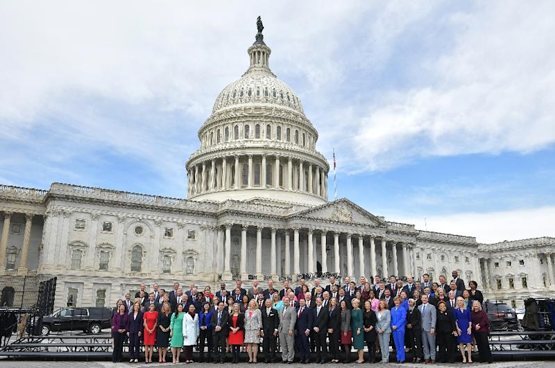 Dozens of members of the freshman class of the US Congress, which will be sworn in on January 3, 2019, gathered for a photograph on the steps of the US Capitol (AFP Photo/MANDEL NGAN)