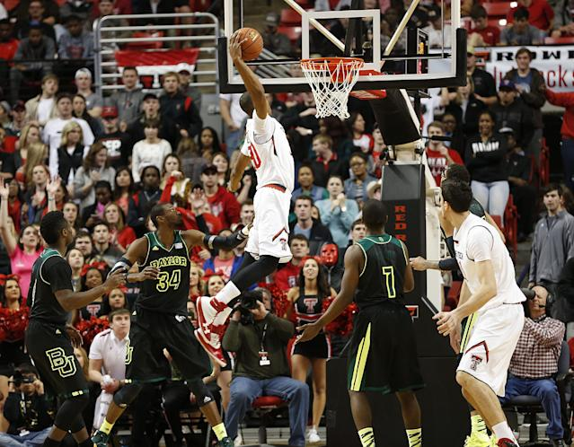 Texas Tech's Jaye Crockett (30) dunks against Baylor during an NCAA college basketball game in Lubbock, Texas, Wednesday, Jan, 15, 2014. (AP Photo/Lubbock Avalanche-Journal, Tori Eichberger)