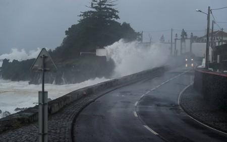 Waves crash on a wall near Angra do Heroismo in Azores