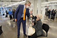 New York Mayor Bill de Blasio, bumps elbows with a woman after she was vaccinated, following his tour of the grand opening of a Broadway COVID-19 vaccination site intended to jump-start the city's entertainment industry, in New York, Monday, April 12, 2021. (AP Photo/Richard Drew, Pool)