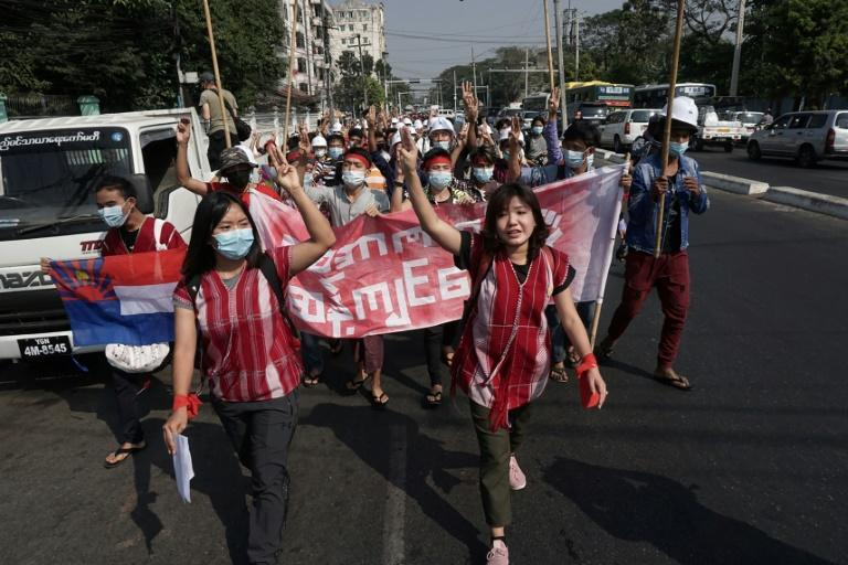 As many as 1,000 demonstrators marched on a road near Yangon University holding up the three-finger salute that has come to symbolise resistance to the army takeover