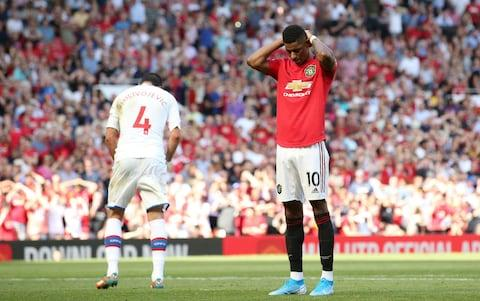 Marcus Rashford of Manchester United reacts after missing from the penalty spot during the Premier League match between Manchester United and Crystal Palace  - Credit: GETTY IMAGES