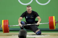 <p>Oleksandr Pyelyeshenko of Ukraine fails a lift during the men's 85kg weightlifting final on August 12, 2016. (REUTERS/Stoyan Nenov) </p>