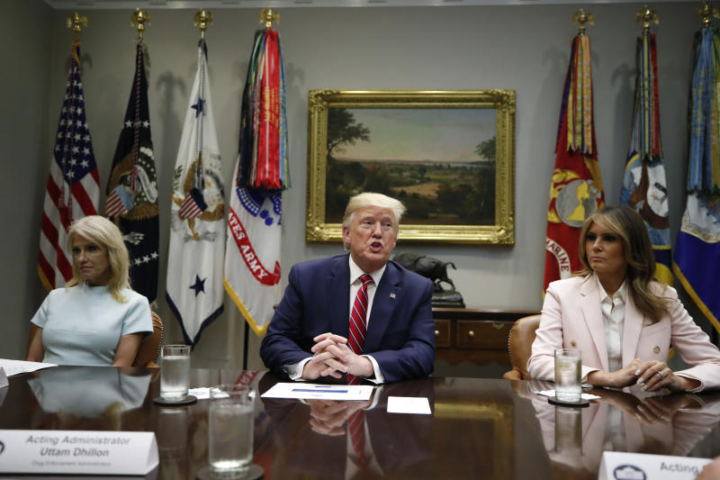 President Donald Trump, first lady Melania Trump, Counselor to the President Kellyanne Conway, left, and others attend a briefing on efforts to combat the opioid crisis in the Roosevelt Room of the White House, Wednesday, June 12, 2019, in Washington. (AP Photo/Alex Brandon)