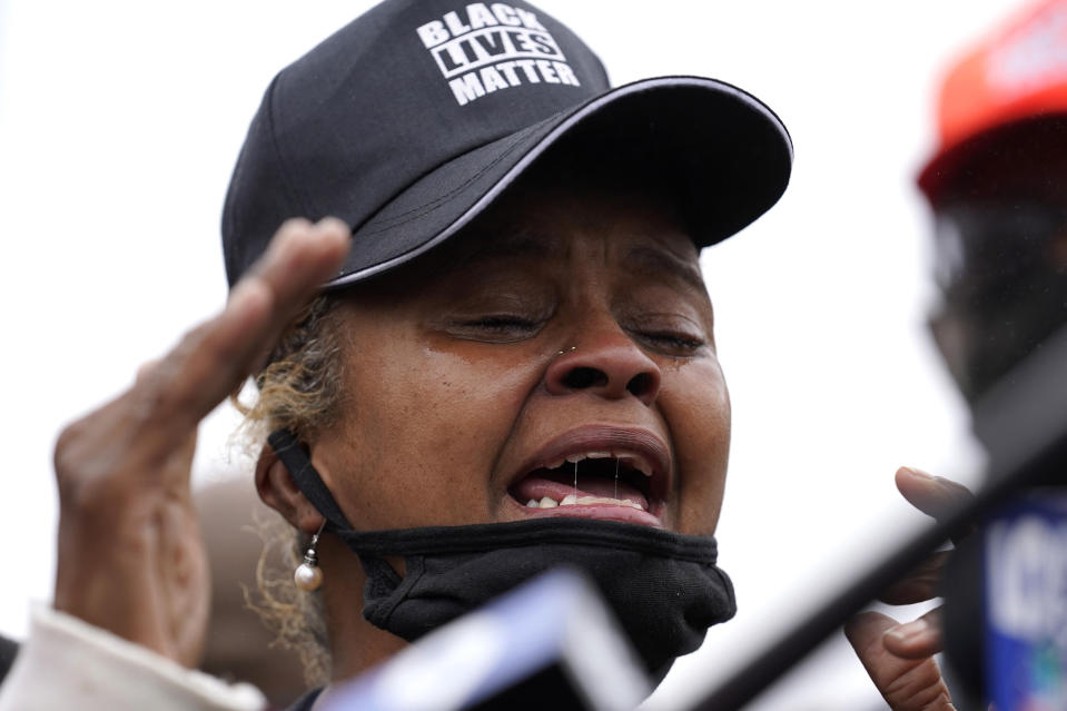Marcellis Stinnette's grand mother Sherrellis Stinnette speaks during protest rally for Marcellis Stinnette who killed by Waukegan Police Tuesday in Waukegan, Ill., Thursday, Oct. 22, 2020. Stinnette, 19, was killed and his girlfriend and the mother of his child, Tafara Williams, was wounded when a police officer in Waukegan opened fire Tuesday night after police said Williams' vehicle started rolling toward the officer following a traffic stop. (AP Photo/Nam Y. Huh)