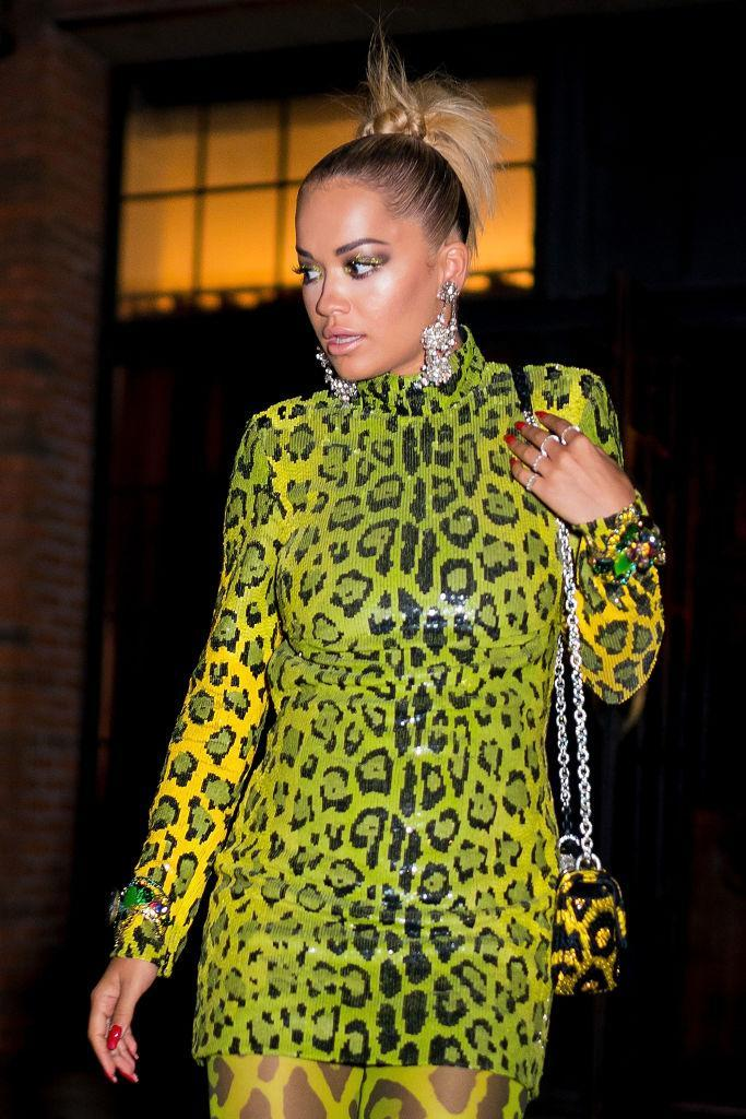 <p>Rita Ora wears a leopard green look in the East Village on Aug. 19 in New York. (Photo: Gotham/GC Images) </p>