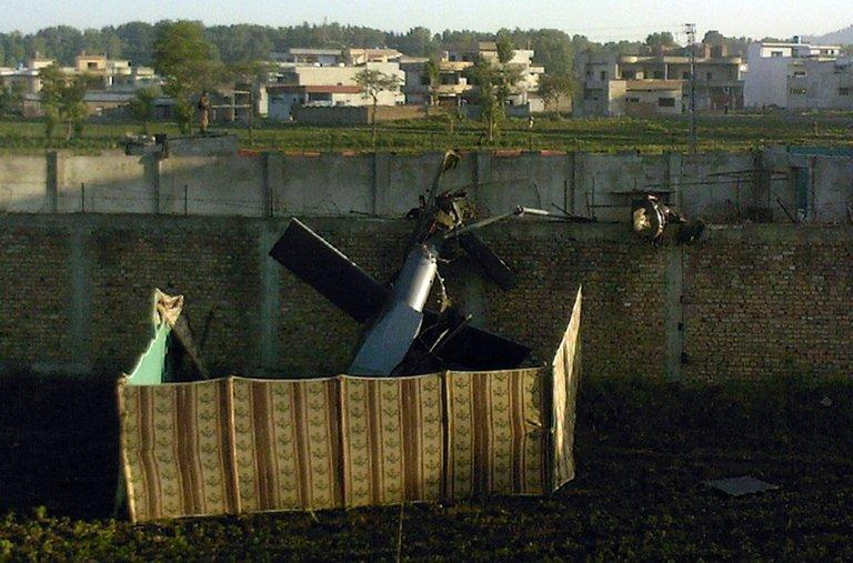 A crashed military helicopter is seen near the hideout of Al-Qaeda leader Osama bin Laden after a ground operation by US Special Forces in Abbottabad on May 2, 2011