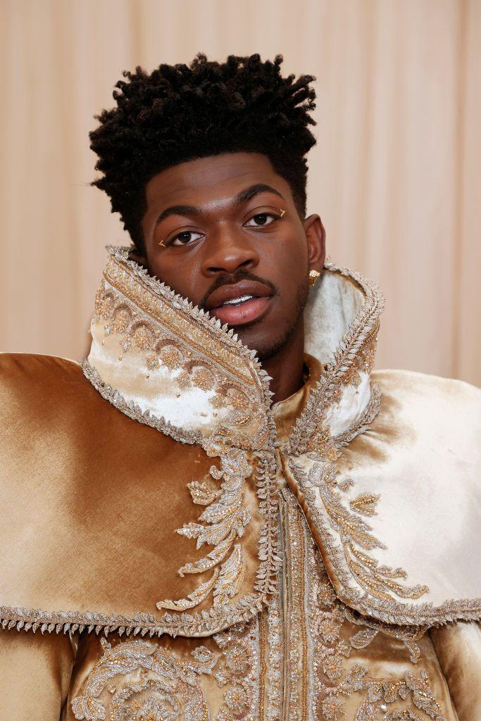 <p>With several outfit changes on the red carpet, Lil Nas X kept his beauty look to a minimum by adding gold accents to the corner of his eyes. </p>