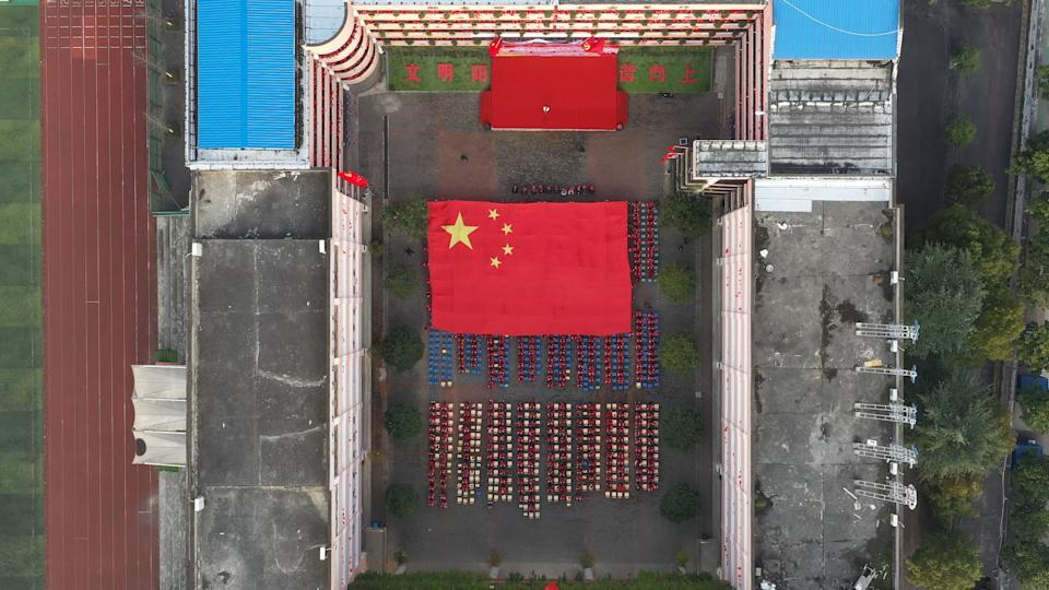 SHIYAN, CHINA - DECEMBER 10, 2020 - A giant five-starred red flag moves past an educational activity attended by more than 1,300 teachers and students in Shiyan city, Hubei province, China, On December 10, 2020.- PHOTOGRAPH BY Costfoto / Barcroft Studios / Future Publishing (Photo credit should read Costfoto/Barcroft Media via Getty Images)