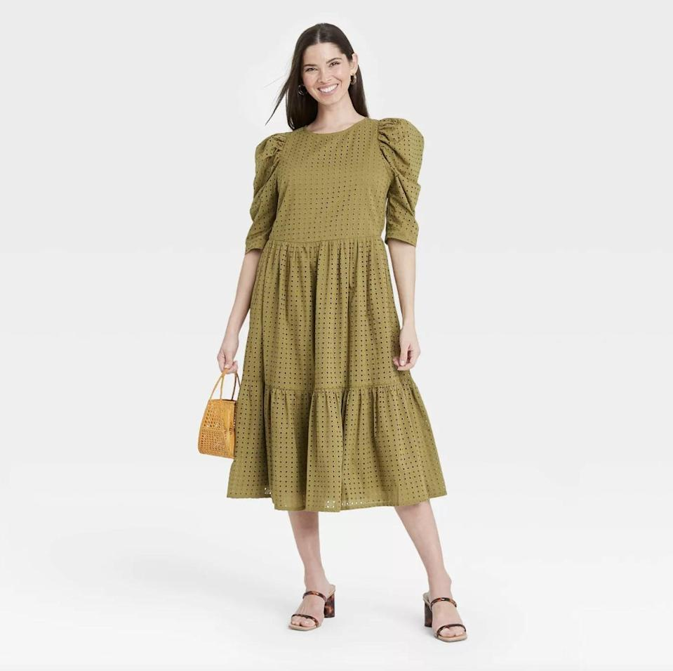 <p>Amp up your spring closet with this vibrant <span>A New Day Elbow Sleeve Eyelet Dress</span> ($30).</p>