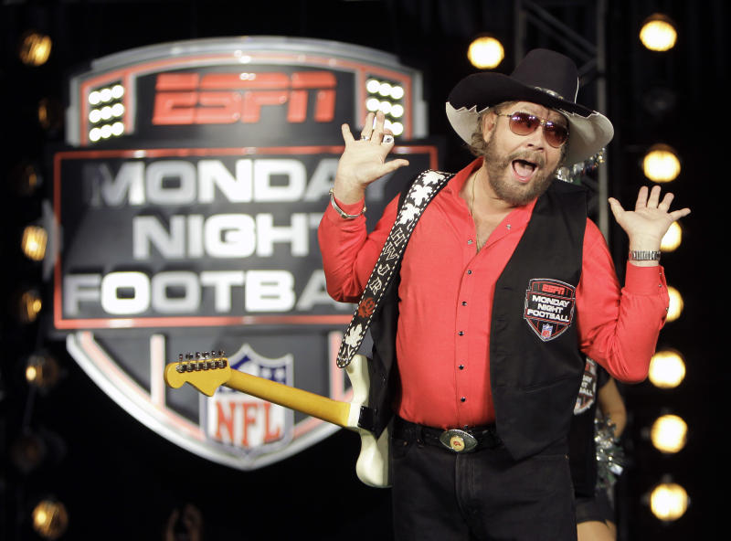 "FILE - In this July 14, 2011, file photo, Hank Williams Jr. performs during the recording of a promo for ESPN's broadcasts of ""Monday Night Football,"" in Winter Park, Fla. Are you ready for some football? Hank Williams Jr. isn't anymore. The country singer and ESPN each took credit for the decision Thursday morning, Oct. 6, 2011,  to no longer use his classic intro to ""Monday Night Football.""  The network had pulled the song from the game earlier this week after Williams made an analogy to Adolf Hitler in discussing President Barack Obama on Fox News on Monday morning.  (AP Photo/John Raoux, File)"