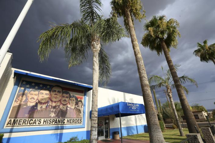 """This Tuesday, July 30, 2019 photo shows the exterior of American Legion Post 41 in Phoenix. The post was established by Mexican Americans after World War II when segregation once ruled the U.S. Southwest as well as the Deep South. It now serves menudo Sunday mornings at the building painted with a mural of service members under the words: """"America's Hispanic Heroes."""" (AP Photo/Ross D. Franklin)"""