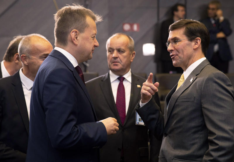 Slovakian Defense Minister Peter Gajdos, center, and Polish Defense Minister Mariusz Blaszczak, left, speak with U.S. Secretary for Defense Mark Esper, right, during a meeting of NATO defense ministers at NATO headquarters in Brussels, Friday, Oct. 25, 2019. NATO defense ministers on Friday are scheduled to discuss efforts to deter Russia in eastern Europe and the future of the mission training security forces in Afghanistan. (AP Photo/Virginia Mayo)