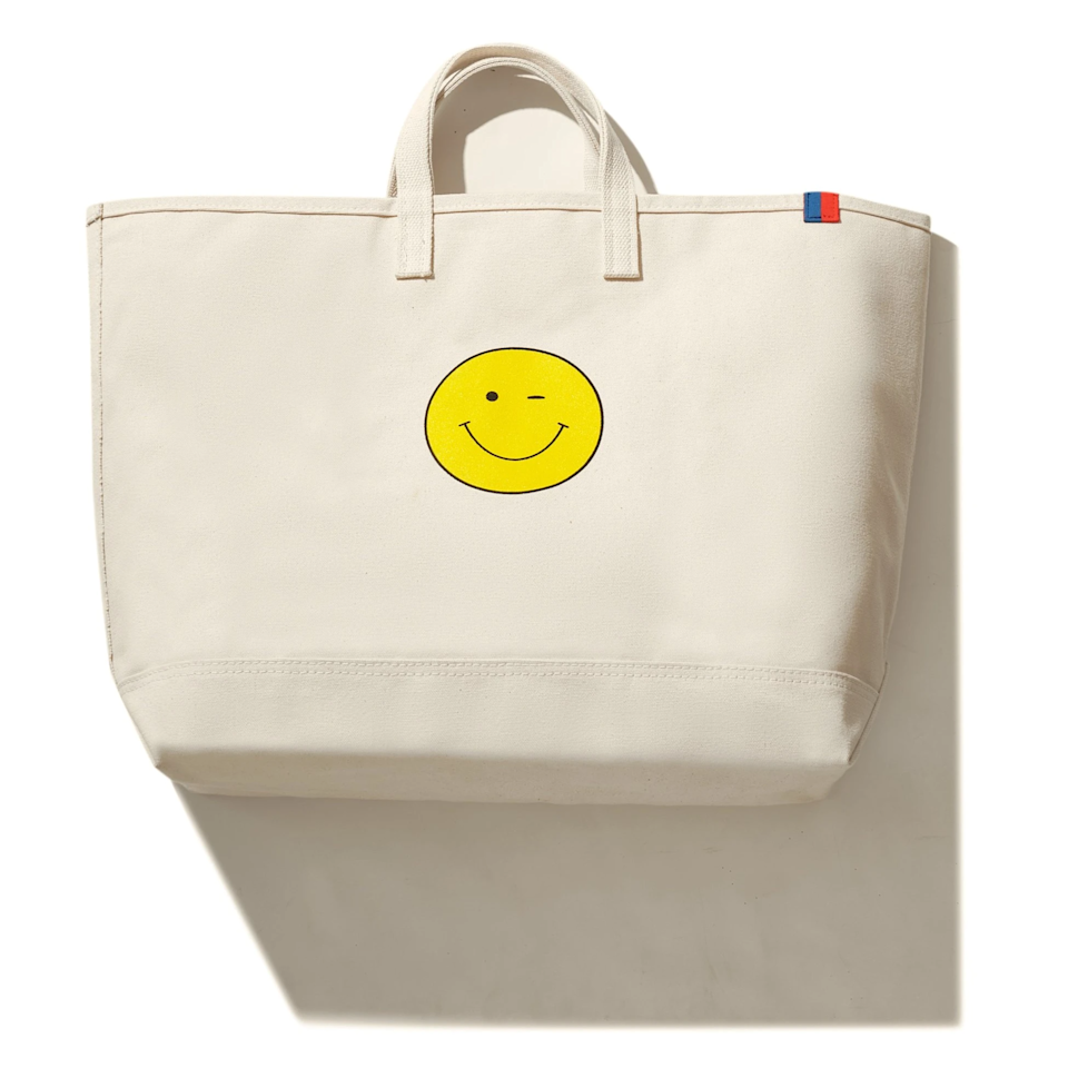 """<h2>Kule The Wink Face Tote</h2><br>Add a little pep to your travel step with this flirty-faced canvas carryall. <br><br>Shop <a href=""""https://www.kule.com/"""" rel=""""nofollow noopener"""" target=""""_blank"""" data-ylk=""""slk:Kule"""" class=""""link rapid-noclick-resp"""">Kule</a><br><br><strong>Kule</strong> The Wink Face Tote, $, available at <a href=""""https://go.skimresources.com/?id=30283X879131&url=https%3A%2F%2Fwww.kule.com%2Fcollections%2Ftotes%2Fproducts%2Fthe-wink-face-tote-canvas"""" rel=""""nofollow noopener"""" target=""""_blank"""" data-ylk=""""slk:Kule"""" class=""""link rapid-noclick-resp"""">Kule</a>"""