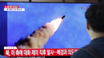 "People watch a TV showing a file image of a North Korea's missile launch during a news program at the Seoul Railway Station in Seoul, South Korea, Tuesday, Sept. 10, 2019. North Korea launched at least two unidentified projectiles toward the sea on Tuesday, South Korea's military said, hours after the North offered to resume nuclear diplomacy with the United States but warned its dealings with Washington may end without new U.S. proposals. The sign reads ""North Korea launched after the North offered to resume nuclear diplomacy with the United States."" (AP Photo/Ahn Young-joon)"