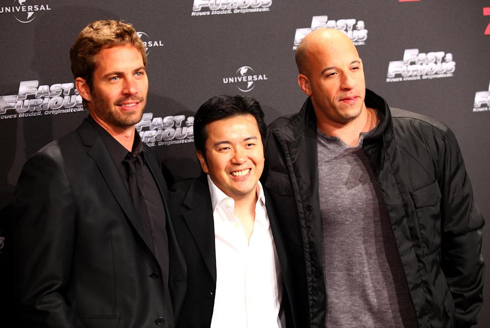 'Fast & Furious' director Justin Lin with Vin Diesel and the late Paul Walker in 2009 (Credit: WENN)